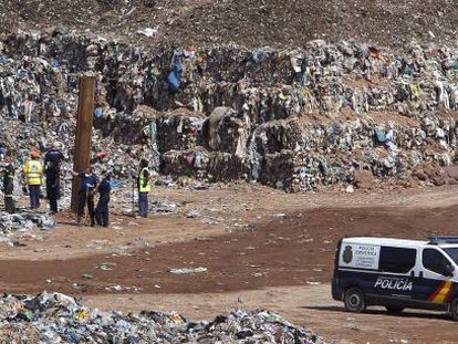 Police agents searching for the missing child at the Dos Aguas garbage dump.