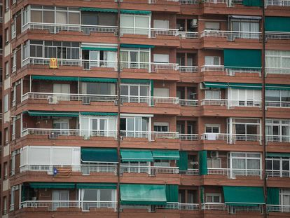 Pro-independence flags hang from an apartment block in Barcelona.