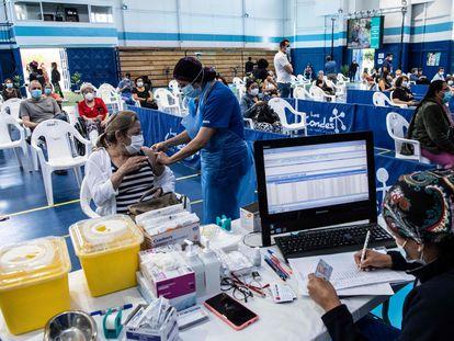A woman receives the Sinovac vaccine at a health center in Santiago de Chile.