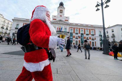 A man dressed as Santa in Madrid's Puerta del Sol.