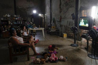 A family watches the news of the 8th Congress of the Communist Party of Cuba.