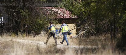 Forensic officers at the location where the latest victim was found.