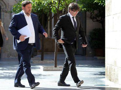 Catalan regional deputy premier Oriol Junqueras, left, with premier Carles Puigdemont.