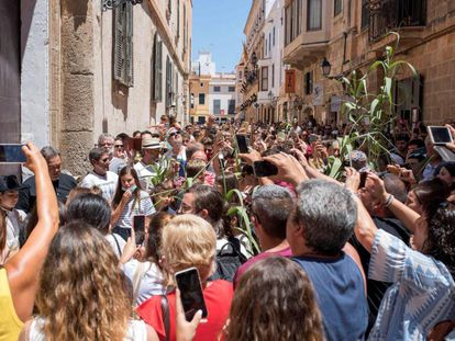 A crowd spontaneously celebrating Saint John's Eve in Ciutadella, Menorca even though official festivities had been cancelled by local authorities.