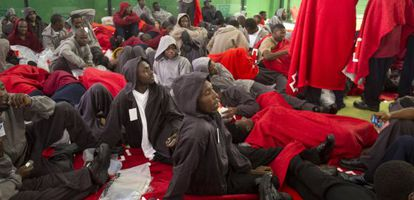 Immigrants rest inside a sports center in Tarifa on Tuesday.
