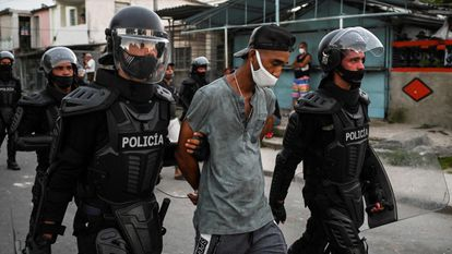 A man is arrested during a demonstration against the government of President Miguel Diaz-Canel in Havana on July 12, 2021.