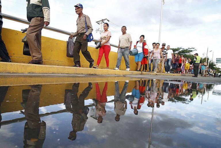 Venezuelans cross into Colombia to buy basic goods.