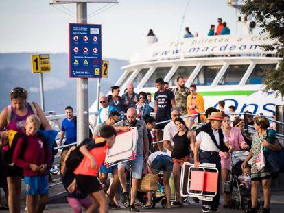 Passengers board a ferry in Vigo, headed for the Cies Islands.