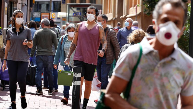 People wearing face masks on the streets of Terrassa in Barcelona on Monday.