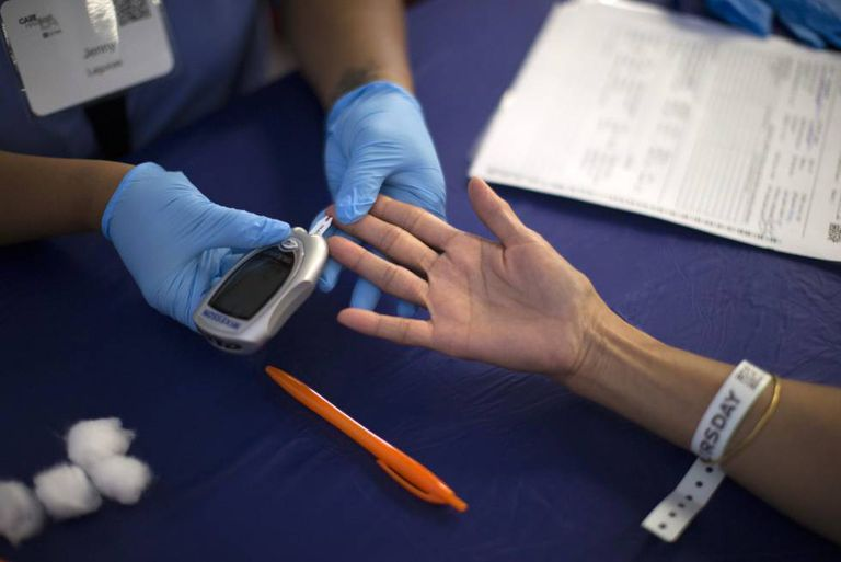 A diabetes test is administered. Up to one-third of people with diabetes can experience skin problems related to the disease.