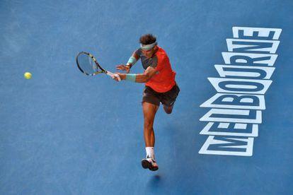 Rafa Nadal returns a shot during his battling win against Kei Nishikori.