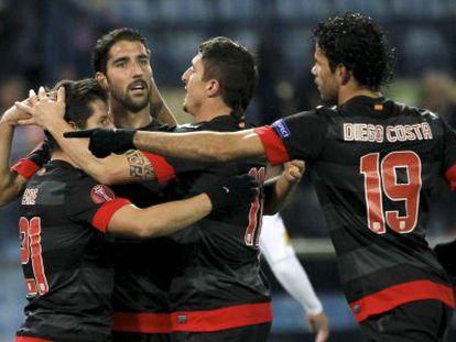 Atletico players (left to right) Emre, Raúl García, Cebolla Rodríguez and Diego Costa celebrate a Europa League goal against Hapoel Tel Aviv.