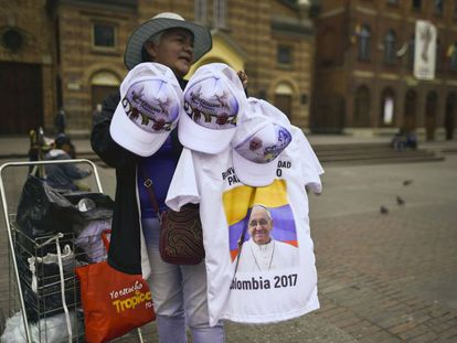 A woman selling pope souvenirs ahead of the visit.