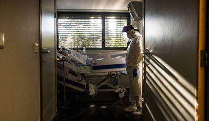 A coronavirus patient at La Paz hospital's emergency ward in Madrid.