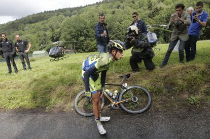 Contador holds his knee after crashing on Monday.