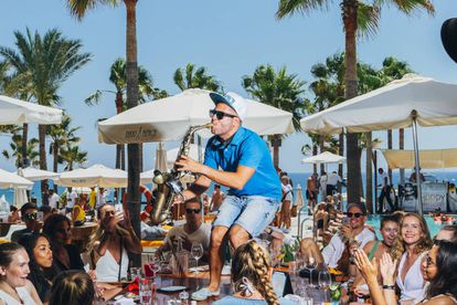 Be careful the saxophonist at Nikki Beach doesn't knock your drink over.