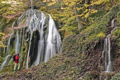 Waterfall among the wooded hills near Goiuri (Álava).