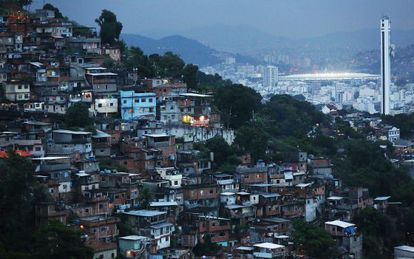 Housing in Rio de Janeiro with Maracaná stadium in the background.