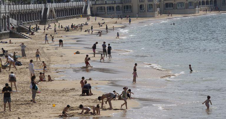 Beachgoers at La Concha beach in San Sebastián.