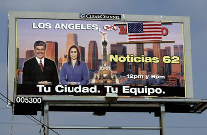 """An American flag has been placed over the word """"Mexico"""" on this billboard in the US."""