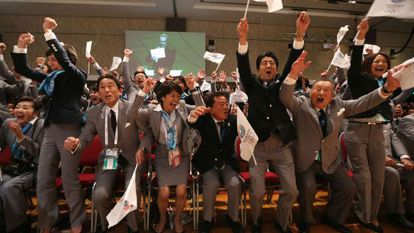 The Tokyo delegation jumps for joy as their successful bid to host the 2020 games is announced.