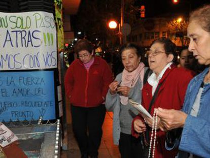 Supporters of President Fernández de Kirchner gather outside the Favaloro Foundation Hospital in Buenos Aires on Monday night.