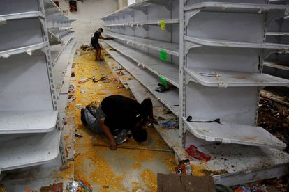 A looted supermarket in Caracas on Friday.