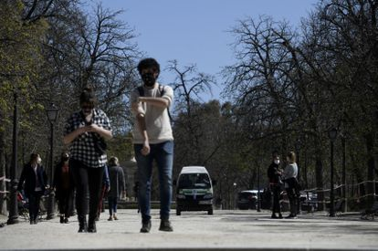 People walking through Madrid's El Retiro park on March 15.