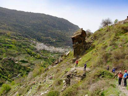 Hikers walk though the Poqueira gorge towards Pampaneira.