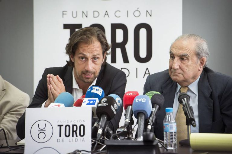 The president of Spain's Bullfighters' Union, Juan Diego (left) with lawyer Vicente Conde, explain the legal action they are to take against people who posted hate messages celebrating the death of bullfighter Víctor Barrio.