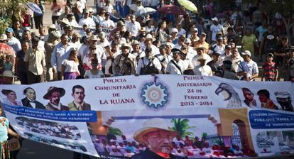 Self-defense groups march in La Ruana on February 24 to mark the movement's first anniversary.