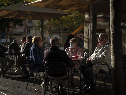 Patrons wear face masks at a sidewalk café in Barcelona on Wednesday.