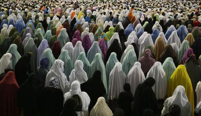 Muslim women pray outside the Great Mosque in Mecca in 2009.
