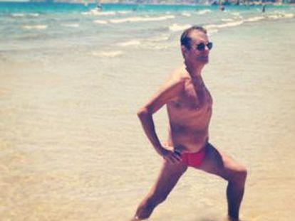 A man exercises on the beach at Benidorm.