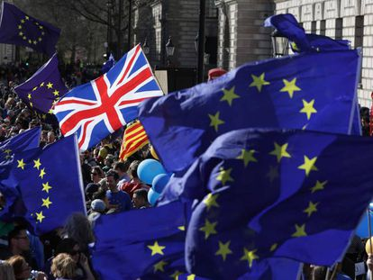 A Union Jack among EU flags at an anti-Brexit march in London.