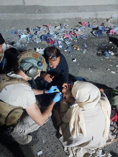 A Spanish doctor treating a child who was injured while entering the base.