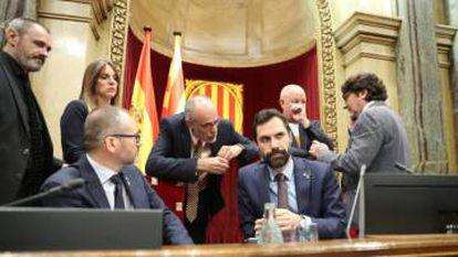 Catalan parliament speaker Roger Torrent (sitting, right).