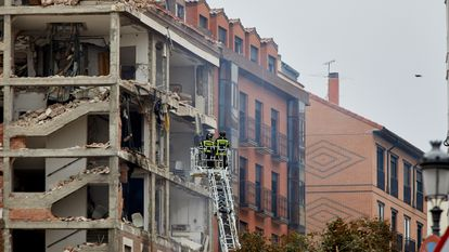 Firefighters inspecting the damage to the building, which authorities said may undergo controlled demolition at a later date.