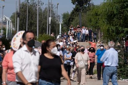 Lines outside a vaccination center at Seville's Olympic Stadium.