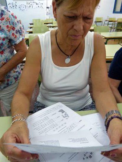 Teodora Trenado reads a poem written by a classmate.