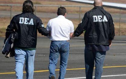 DEA agents arrest a drug suspect.