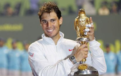 Rafael Nadal with the Qatar Open winner's trophy.