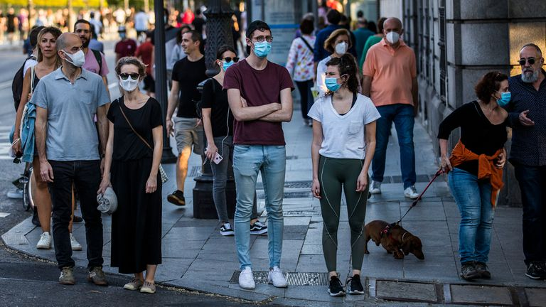 Pedestrians, some wearing masks, on Madrid's Bailen street this weekend.