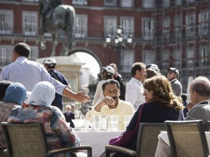Tourists in Madrid's Plaza Mayor.