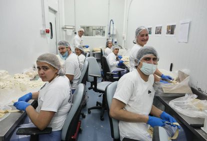 Staff at the Antojos Araguaney factory in Rivas-Vaciamadrid making 'tequeños' – breaded cheese sticks that are popular in Venezuela.