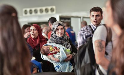 The Al Said family waits inside Beirut airport for their flight to Spain.