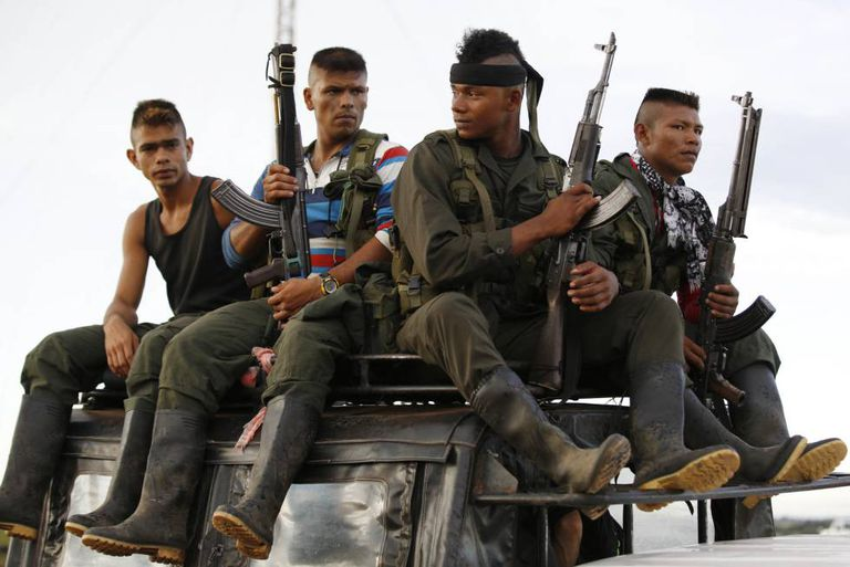 A group of rebel soldiers arrives at El Diamante to attend the last FARC conference.