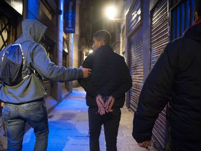 A youth being detained in Barcelona.
