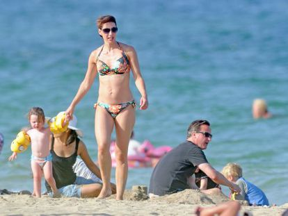 David Cameron relaxes on a Mallorca beach with his wife, Samantha, and daughter, Florence.