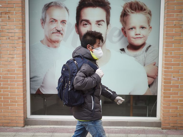 A man wears a protective face mask and gloves in the Spanish city of Pamplona.
